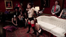 Alice Picket and Audrey Holiday are mid the subs at a BDSM party
